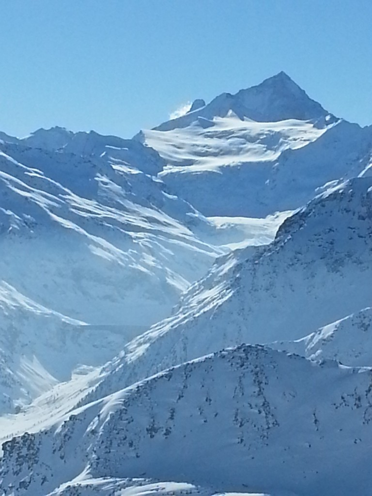 The tip of the Matterhorn sticking out from behind the Dent Blanche (view from Grimentz)